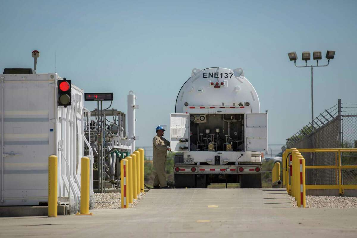 Miguel Cortillo opens up the back of a liquefied natural gas to fill up the tank at Stabilis Energy in George West to transport it to Laredo on Tuesday, April 2, 2019.