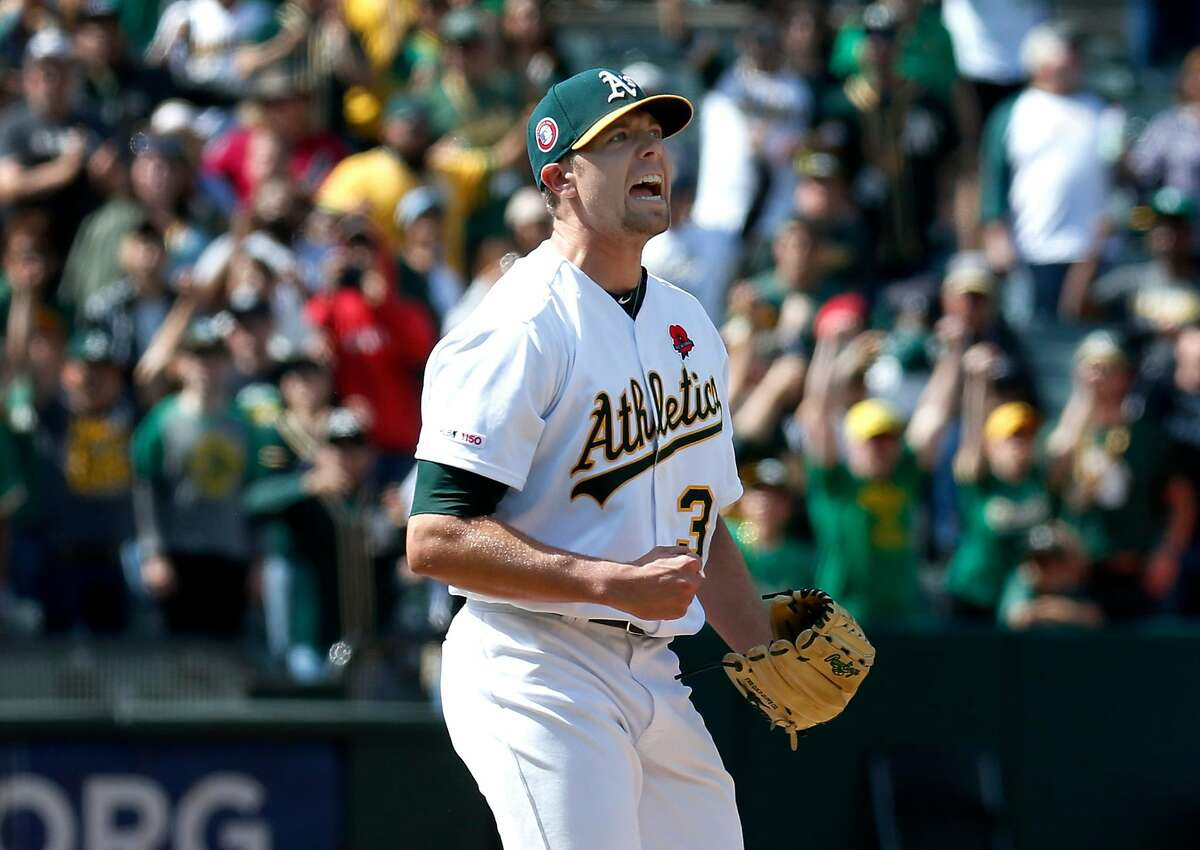 Closer Blake Treinen lets out a yell after the Oakland A's recorded the final out against the Los Angeles Angels at the Coliseum to extend the team's winning streak in Oakland, Calif. on Monday, May 27, 2019.