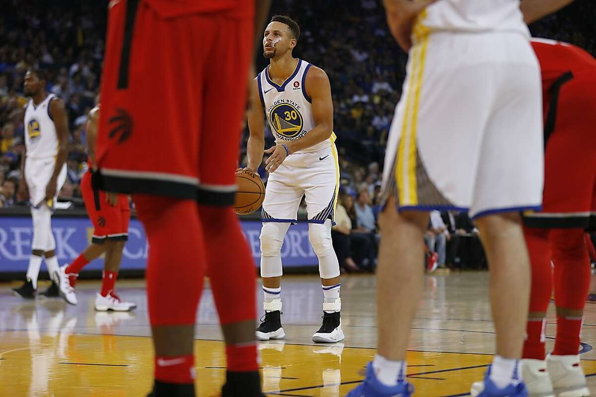 Golden State Warriors guard Stephen Curry (30) goes to the line for free throws during the first half of an NBA game between the Golden State Warriors and Toronto Raptors at Oracle Arena on Wednesday, Oct. 25, 2017, in Oakland, Calif. The Warriors won 117-112.