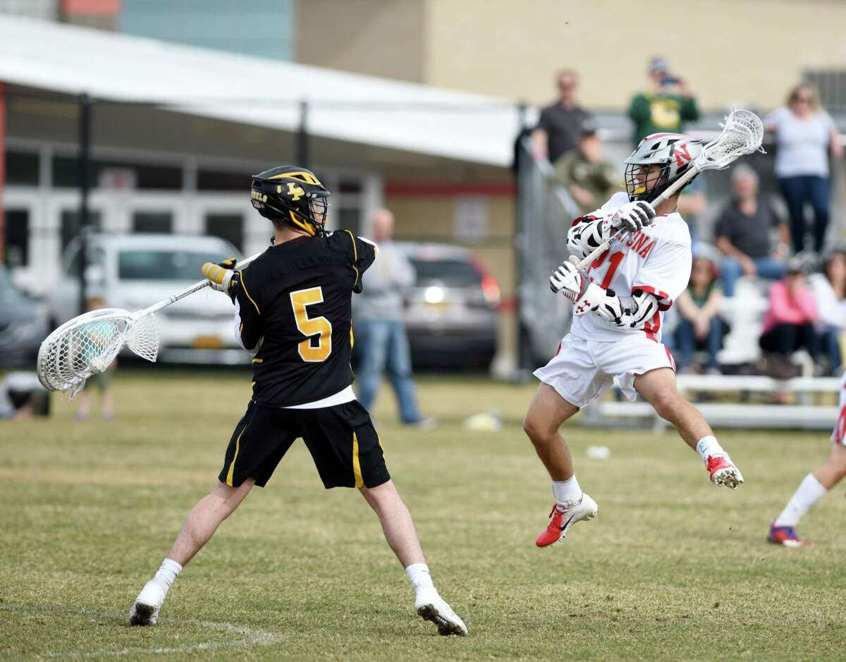 Niskayuna Brock Behrman jumps up in front of the goal during a game against Lakeland-Panas on Saturday, April 13, 2019 at Niskayuna High School in Niskayuna, NY. (Phoebe Sheehan/Times Union)