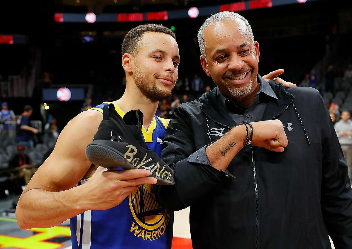 Stephen Curry of the Golden State Warriors poses with his dad Dell Curry after their 128-111 win over the Atlanta Hawks at State Farm Arena on December 3, 2018 in Atlanta. Steph won the yearly bet he has with this father after he placed higher than Dell at the American Century Championship celebrity golf tournament in South Lake Tahoe.
