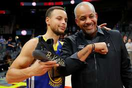 ATLANTA, GA - DECEMBER 03: Stephen Curry #30 of the Golden State Warriors poses with his dad Dell Curry after their 128-111 win over the Atlanta Hawks at State Farm Arena on December 3, 2018 in Atlanta, Georgia. NOTE TO USER: User expressly acknowledges