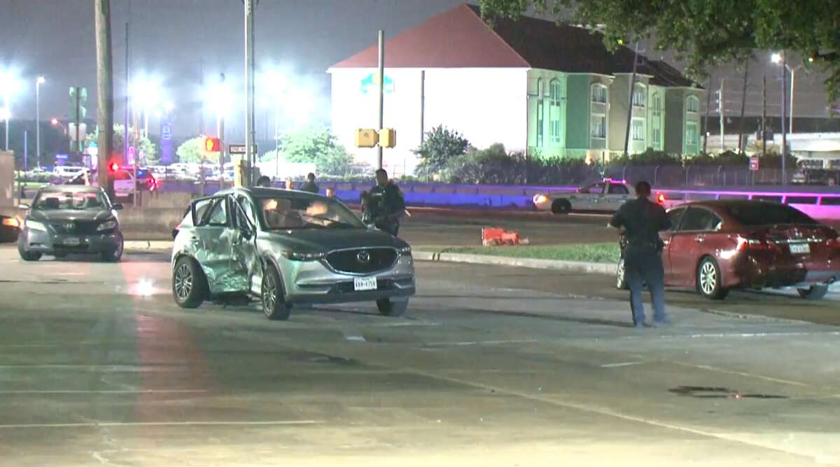 Houston police clear the scene of a crash that killed one passenger late Monday, May 27, at West Sam Houston Parkway at Harwin.