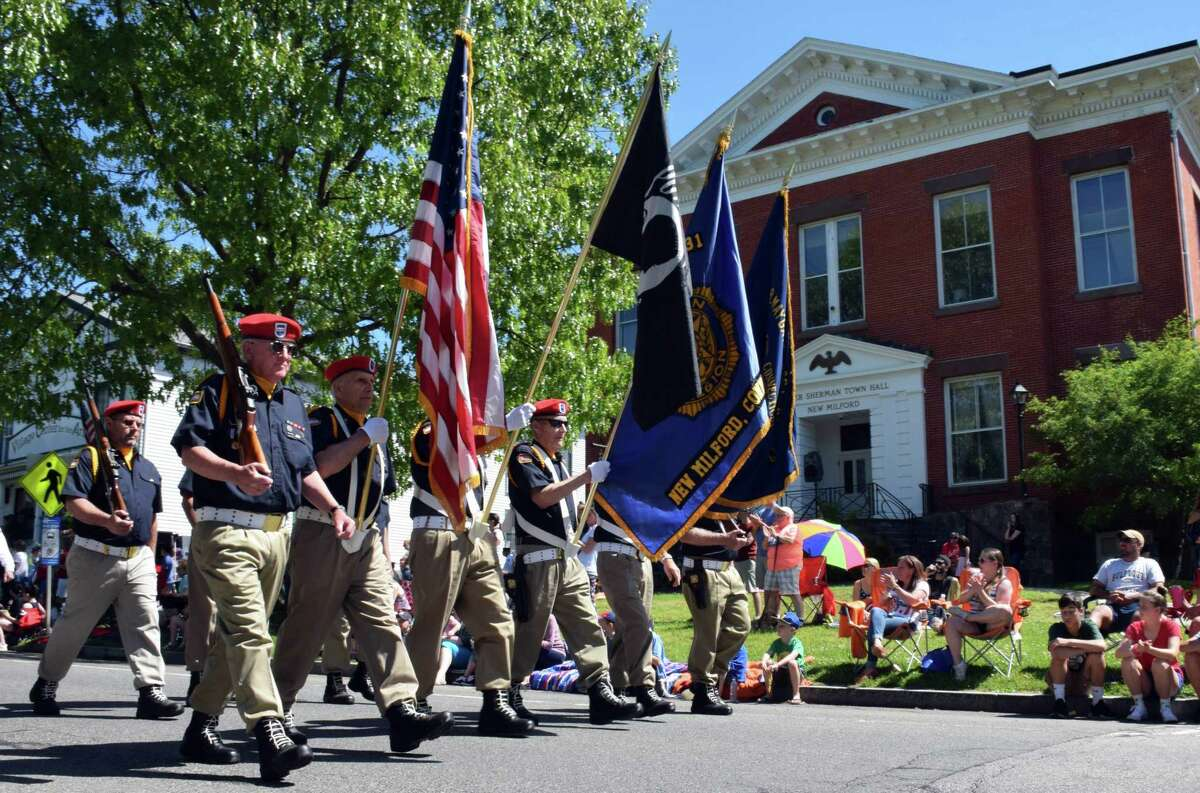 Spectrum/New Milford recognized Memorial Day with a ceremony in front of the New Milford Public Library, followed by a parade downtown. May 27, 2019. Above, veterans lead the way along the parade route on Main Street, with Roger Sherman Town Hall in the background.