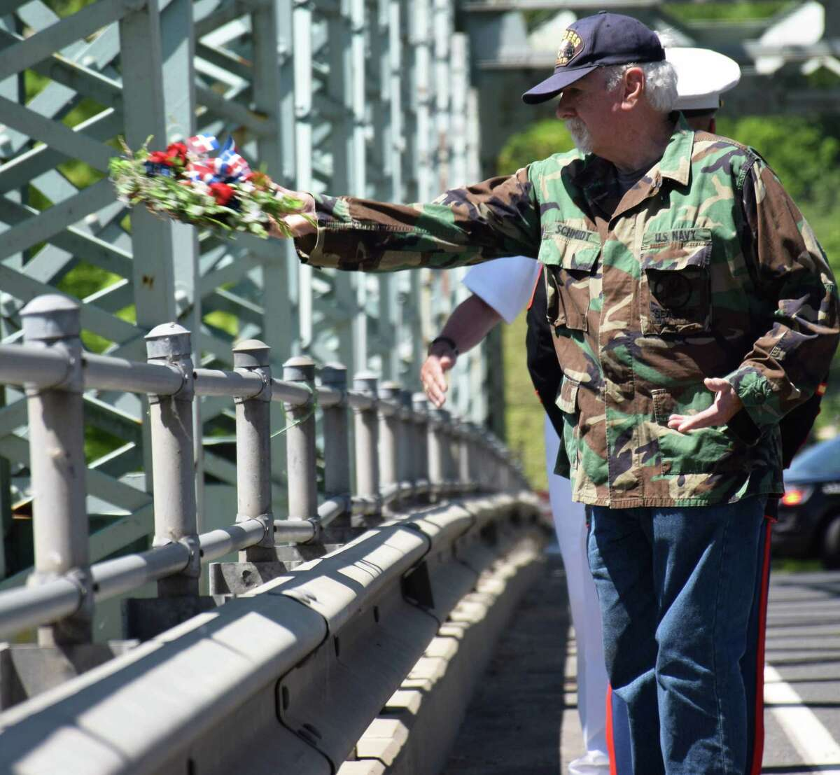 Spectrum/New Milford recognized Memorial Day with a ceremony in front of the New Milford Public Library, followed by a parade downtown. May 27, 2019. Above, Chief Petty Officer Martin Schmidt tosses the mariner's wreath from Veterans Memorial Bridge into the Housatonic River.