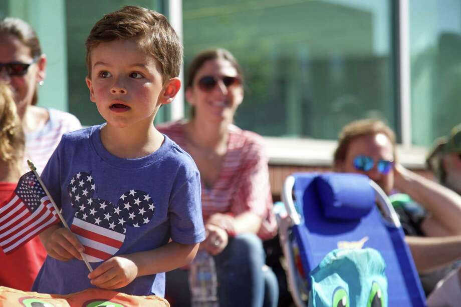 Dominic Vinci, 4, of Norwalk, marvels at the spectacle of the Memorial Day parade on Monday, May 27, 2019, in Westport, Conn. Photo: Jarret Liotta / For Hearst Connecticut Media / Westport News Freelance