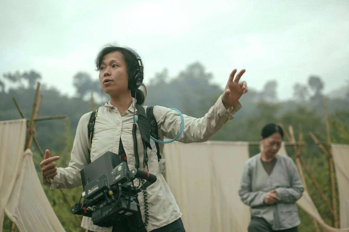 Director Ash Mayfair directs a scene on the set of 'The Third Wife' (Nguoi Vo Ba). This is her first feature film.