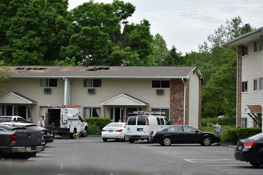 Four units in the Harry Brook Village condominiums were damaged by an early morning fire Tuesday, May 28, 2019. Photo: Kendra Baker / Hearst Connecticut Media