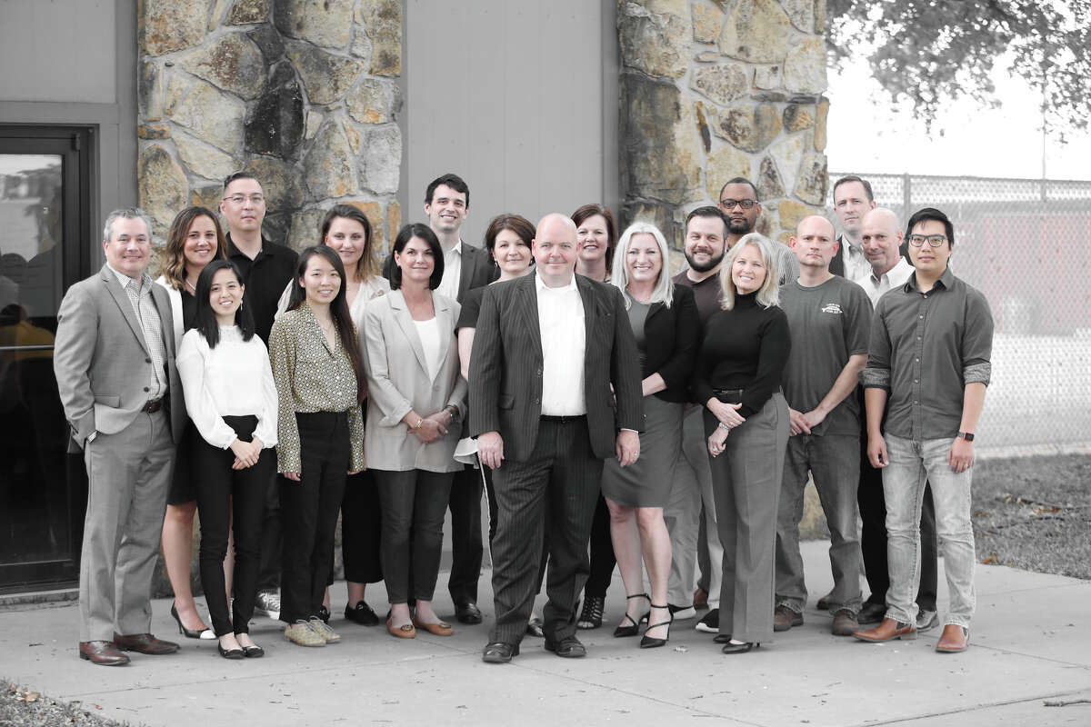 Andrew Bruce, center, the CEO of Houston-based Data Gumbo, poses with his employees.