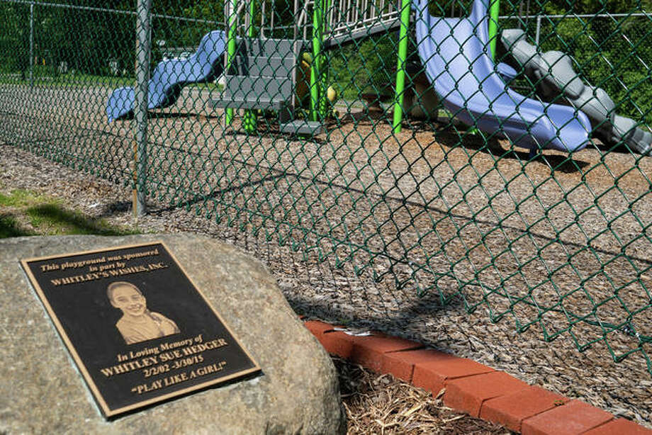 At Vadalabene Park, where Whitley's Wishes helped build a playground, the city recently added a memorial plaque for Whitley. Photo: Breanna Booker | The Intelligencer