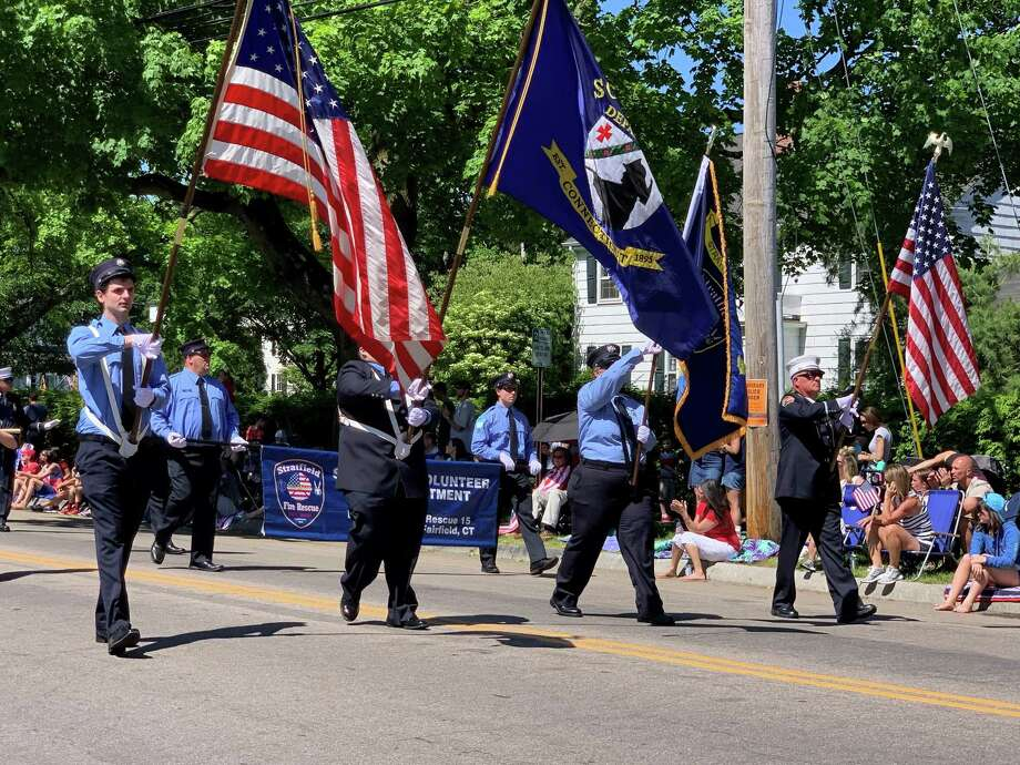 Volunteer firefighters were among the many organizations marching in the Memorial Day Parade. Photo: Kendra Wingate/ For Hearst Connecticut Media