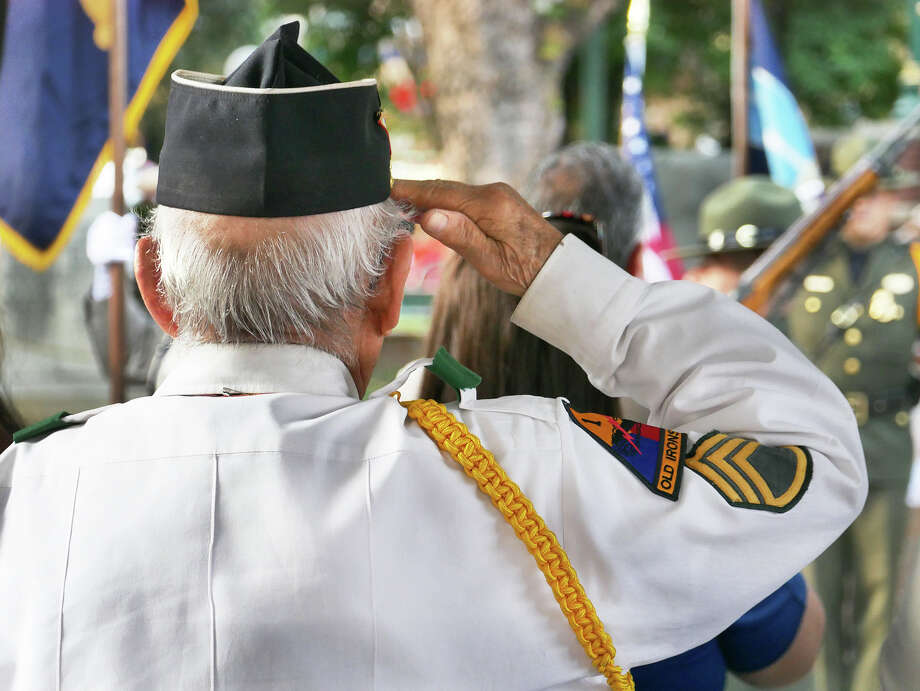 Korean War veteran Salvador Sciaraffa salutes as the colors are presented at the annual Memorial Day ceremony hosted by the Korean War Veterans Association Laredo 1950 - Chapter 209 and The Daughters of the American Revolution, Monday, May 27, 2019 at Jarvis Plaza. This year's ceremony was dedicated to Laredo's POW-MIAs. Photo: Cuate Santos/Laredo Morning Times