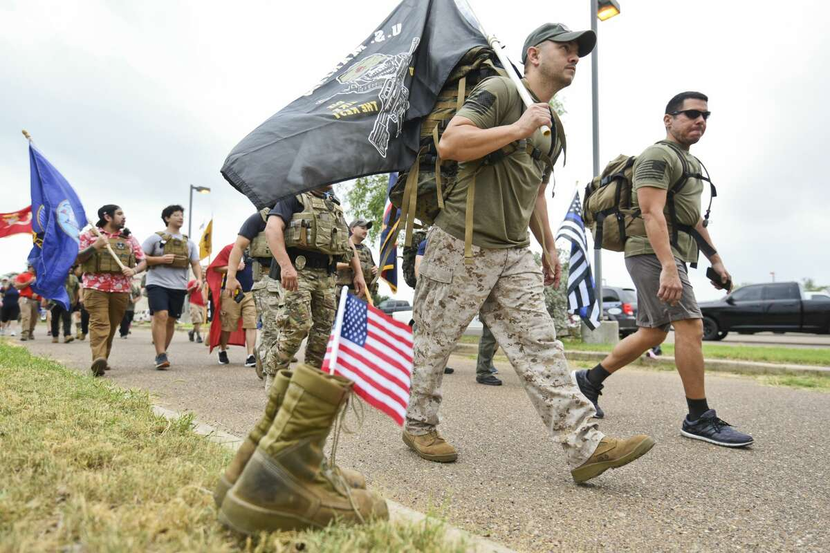 Veterans and patriotic civilians participate in the Freedom Ruck on Saturday, May 25, 2019, as they display flags during their walk from the Texas Army National Guard to Texas A& International University wearing weighted rucksacks in observance of Memorial Day.