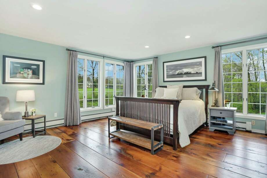 The master bedroom features two walk-in closets and a newly renovated master bath.