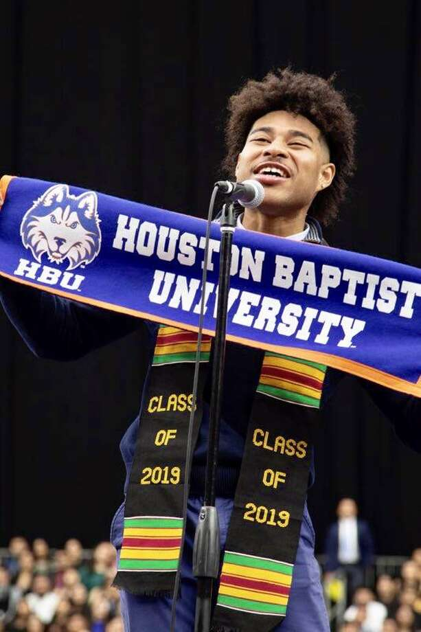 Marcus Brown-Salinas proudly declares he will attend Houston Baptist University during the annual YES Prep Senior Signing Day at NRG. Brown-Salinas, a member of the inaugural graduating class at YES Prep Northbrook in Spring Branch ISD, is the first in his family to go to college. Photo: Courtesy Photo
