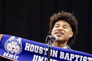 Marcus Brown-Salinas proudly declares he will attend Houston Baptist University during the annual YES Prep Senior Signing Day at NRG. Brown-Salinas, a member of the inaugural graduating class at YES Prep Northbrook in Spring Branch ISD, is the first in his family to go to college.