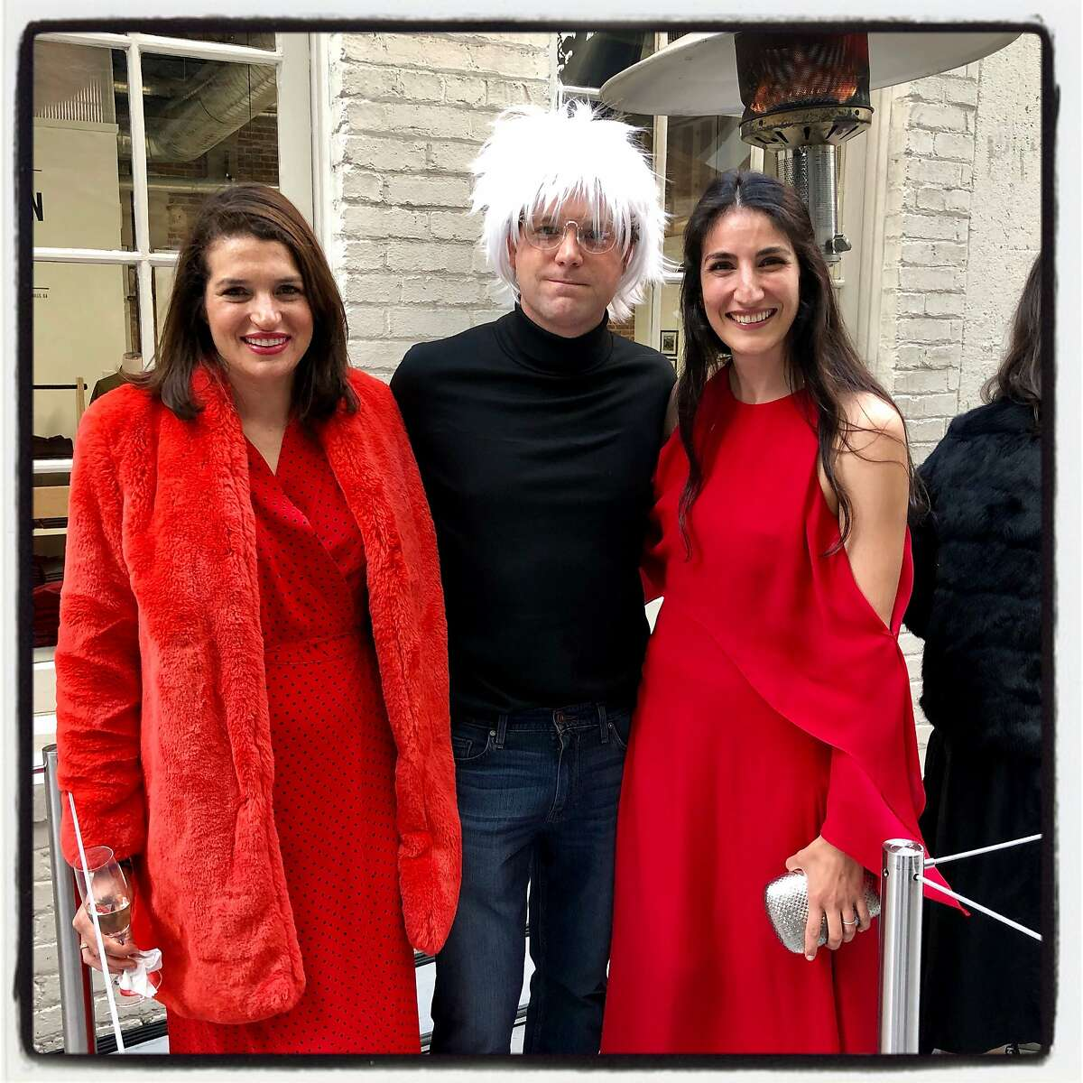 Lexie Fisher George (left) with her husband, a Warhol-wigged Mark George, and Phillips gallerist Sophia Kinell at Art Bash. May 22, 2019.
