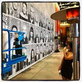 A guests admires the JR art installation at SFMOMA Art Bash. May 22, 2019.