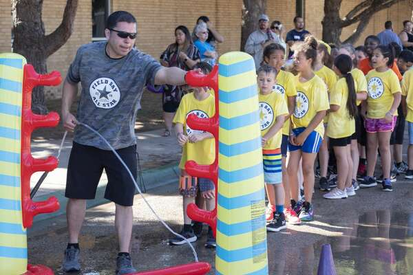 General Franks Elementary coach and Physical Education teacher Ruben Ochoa sets up a water limbo 05/22/19 as students participate in field day fun. Tim Fischer/Reporter-Telegram