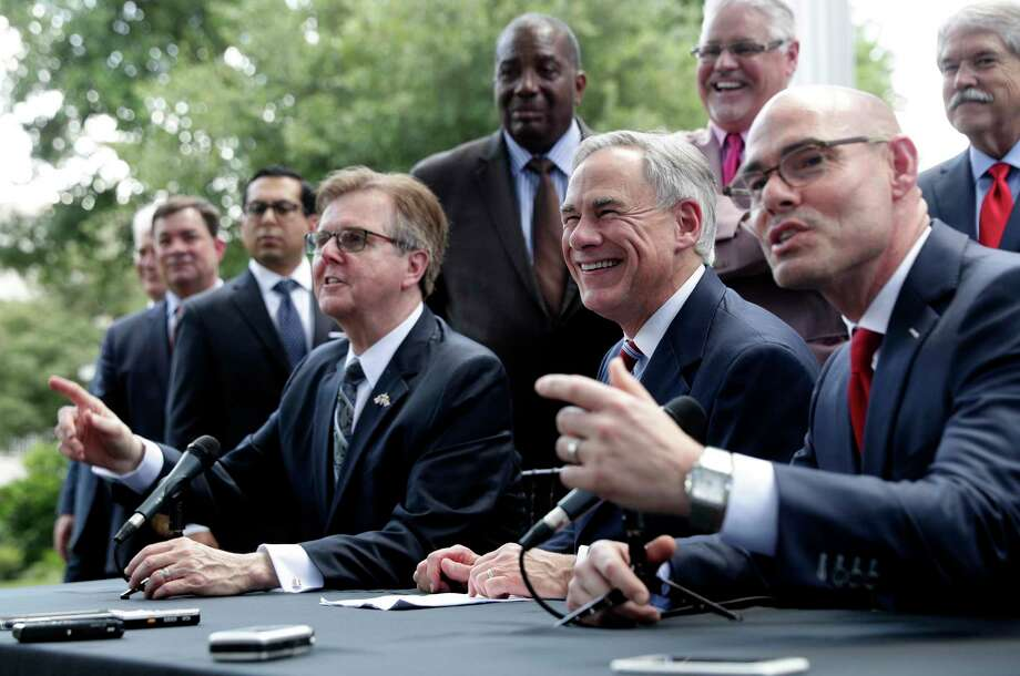 Governor Greg Abbott, seated center, Lt. Governor Dan Patrick, seated left, and Speaker of the House Dennis Bonnen, seated right, and other law makers attend a joint press conference to discuss teacher pay and school finance at the Texas Governor's Mansion in Austin, Texas, Thursday, May 23, 2019, in Austin. (AP Photo/Eric Gay) Photo: Eric Gay, STF / Associated Press / Copyright 2019 The Associated Press. All rights reserved.
