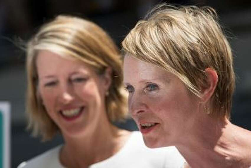 (L-R) Zephyr Teachout, law professor at Fordham University and candidate for New York Attorney General, looks on as Cynthia Nixon, Democratic candidate for governor of New York, speaks during a press conference outside of Trump Tower in Midtown Manhattan, August 8, 2018 in New York City. Teachout and Nixon endorsed each other's campaigns during the press conference.