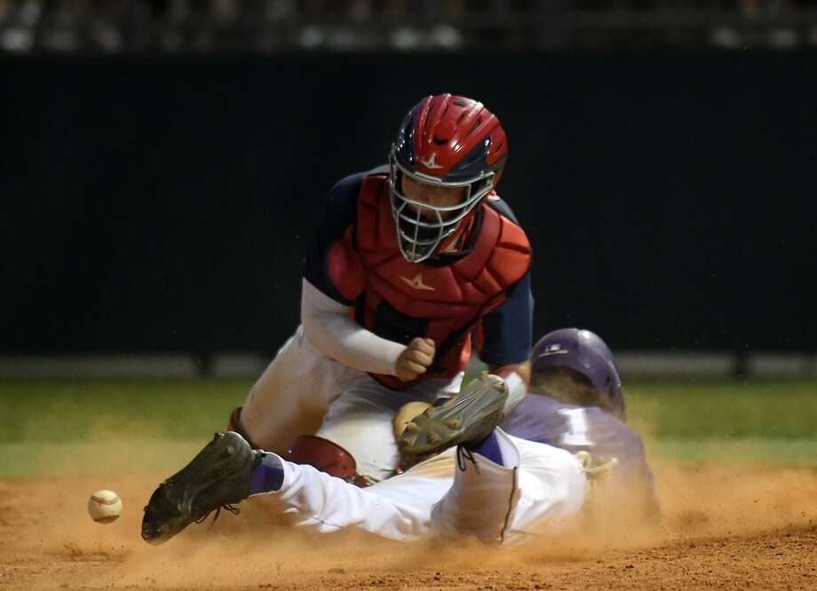 Atascocita catcher Tyler Byrd tries to make a play on Ridge Point baserunner Preston Steszewski (1) during the bottom of the 5th inning of game two of their Region III-6A Semi-final playoff matchup at Ridge Point High School on May 24, 2019. Photo: Jerry Baker, Houston Chronicle / Contributor / Houston Chronicle
