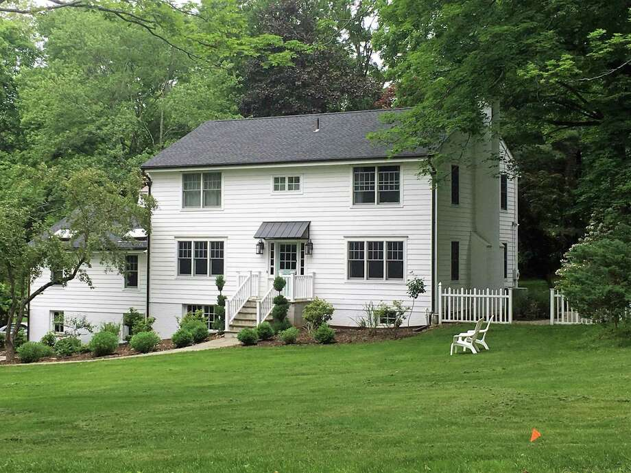 The white colonial house at 29 Punch Bowl Drive sits on a 1.74-acre corner lot convenient to downtown Westport. Photo: Contributed Photos