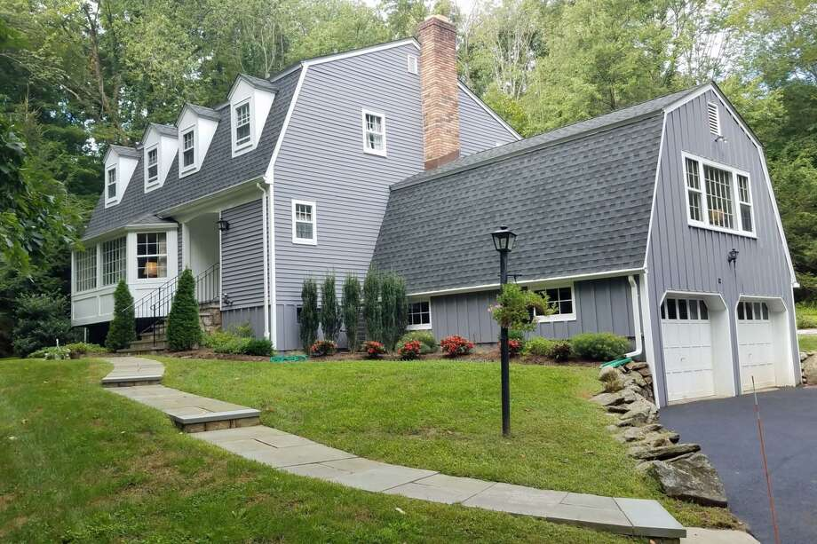 The Dutch colonial house at 62 Kettle Creek Road sits on almost three acres in Lower Weston.