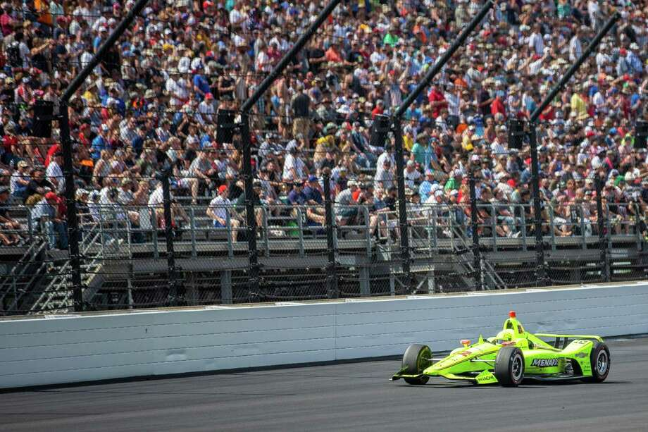 TOPSHOT - Simon Pagenaud of France drives the #22 Menards Team Penske Chevrolet during the 103rd running of the Indianapolis 500 at Indianapolis Motor Speedway on May 26, 2019 in Indianapolis, Indiana. - France's Simon Pagenaud won the 103rd Indianapolis 500 Sunday, holding off Alexander Rossi in a fierce finishing duel to win America's fabled race for the first time. Penske driver Pagenaud started from pole position and led 116 laps of the 200-lap race on the 2.5-mile oval of the Indianapolis Motor Speedway, finishing in front of two former winners in Andretti Autosport's Rossi and Rahal Letterman Lanigan Racing's Takuma Sato of Japan. (Photo by Kerem Yucel / AFP)KEREM YUCEL/AFP/Getty Images Photo: KEREM YUCEL / AFP/Getty Images / AFP or licensors
