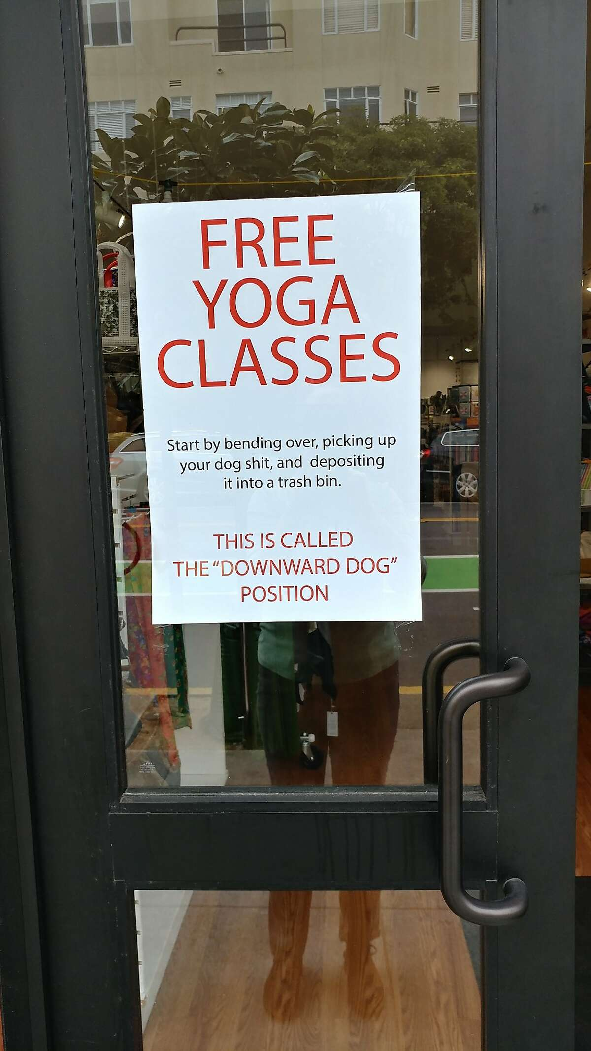 Sign on front of Polk Street store