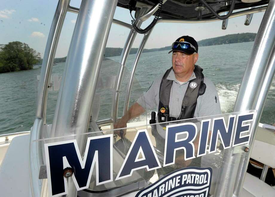 Ron Barnard of the Candlewood Lake Authority Marine Patrol, out on the lake, Monday, July 2, 2018. Photo: Carol Kaliff / Hearst Connecticut Media / The News-Times