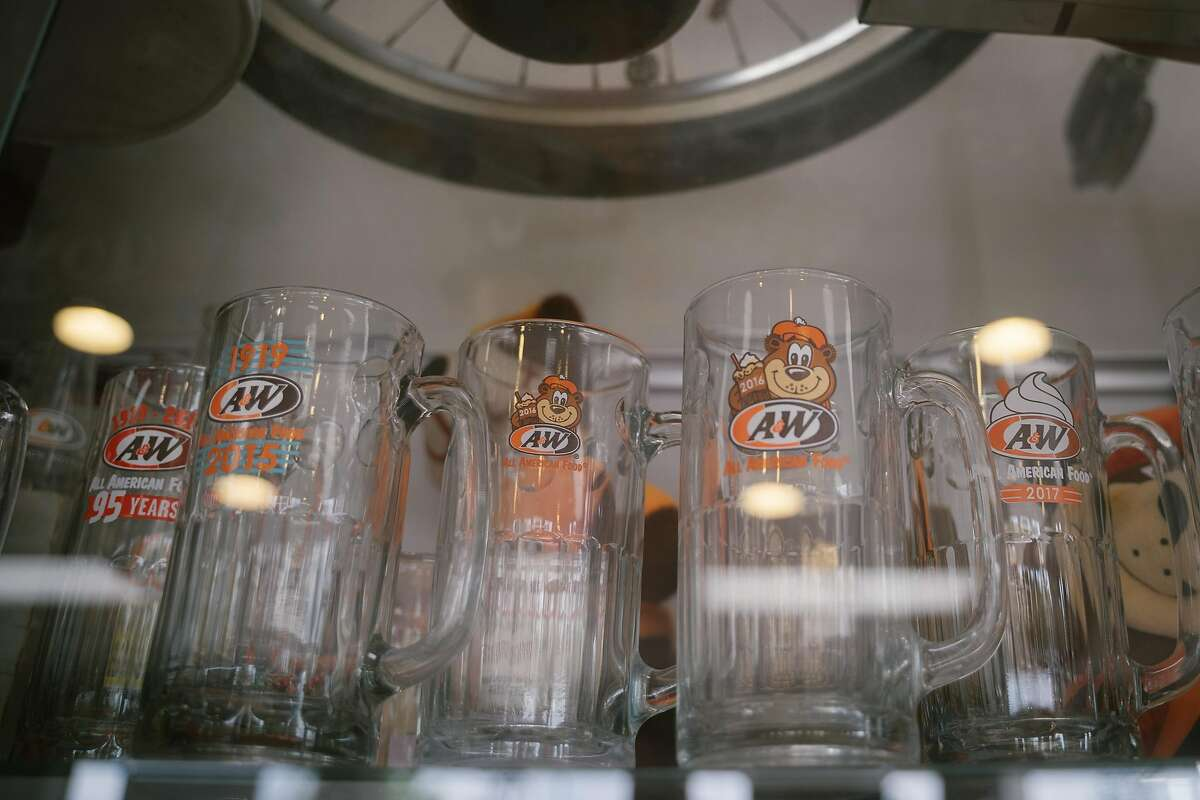 A glass mug collection is displayed at the A&W restaurant in Lodi, Calif., on Monday, May 27, 2019. The A&W franchise originally founded in Lodi, will be celebrating its 100th anniversary in June.
