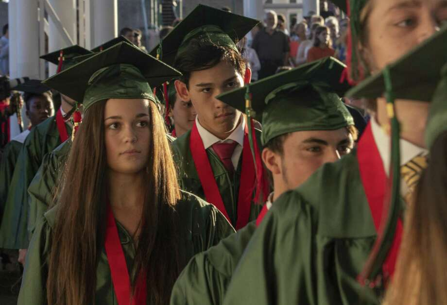The Woodlands High School seniors enter the arena during a graduation ceremony Friday, May 24, 2019 at The Cynthia Woods Mitchell Pavilion in The Woodlands. Photo: Cody Bahn, Houston Chronicle / Staff Photographer / © 2018 Houston Chronicle