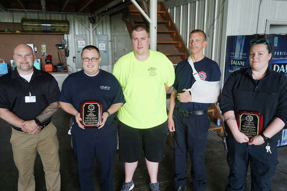 Left to right are Alex Campbell, Bethalto Fire Department Assistant Chief James Schulte, Capt. Dan Bartels of the BFD, Brian Buhs of the BFD and AMH EMT Nicole Larson. Not pictured is AMH paramedic Travis Bryson.