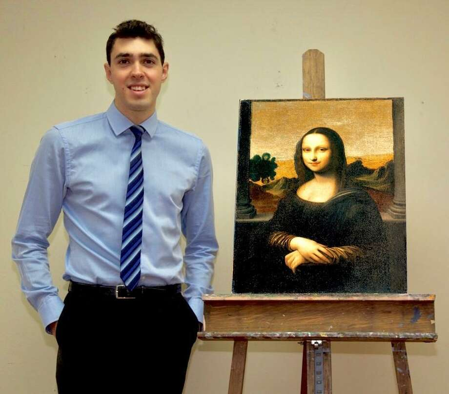 "Art Historian Matt Soltis with copy of the ""second"" Mona Lisa, which is being authenticated Photo: Kent Art Association / Contributed Photo"