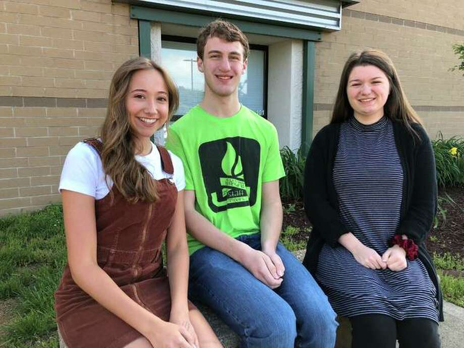 Metro East Lutheran High School's Valedictorian Joshua Jacobsen (center) and Co-Salutatorians Olivia Badalamenti (left) and Angela Gausmann (right). Photo: Julia Biggs | The Intelligencer