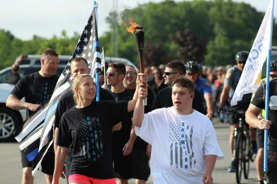 The Law Enforcement Torch Run for Special Olympics Connecticut makes its way across the state every June on its way to the summer games opening ceremonies at Southern Connecticut State University's Friday evening June 7. Photo: Contributed Photo