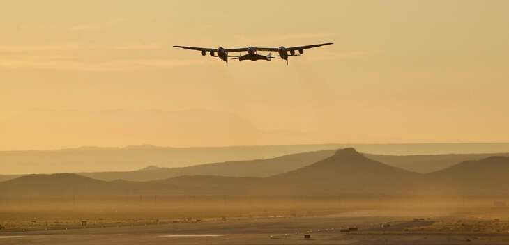 A jet carrying Virgin Galactic's tourism spaceship has taken off from Mojave Air and Space Port on Thursday, Dec. 13, 2018 in Mojave, Calif. The jet will climb to an altitude near 43,000 feet and then release Virgin Space Ship Unity. The pilots hope to fly the rocket ship to an altitude exceeding 50 miles (80 kilometers), which Virgin Galactic considers the boundary of space.
