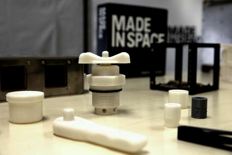 A few example of the types of parts that can be made with a 3D printer in space are displayed at Made In Space on February 19, 2016, in Mountain View, California. (Michael Macon/San Francisco Chronicle)