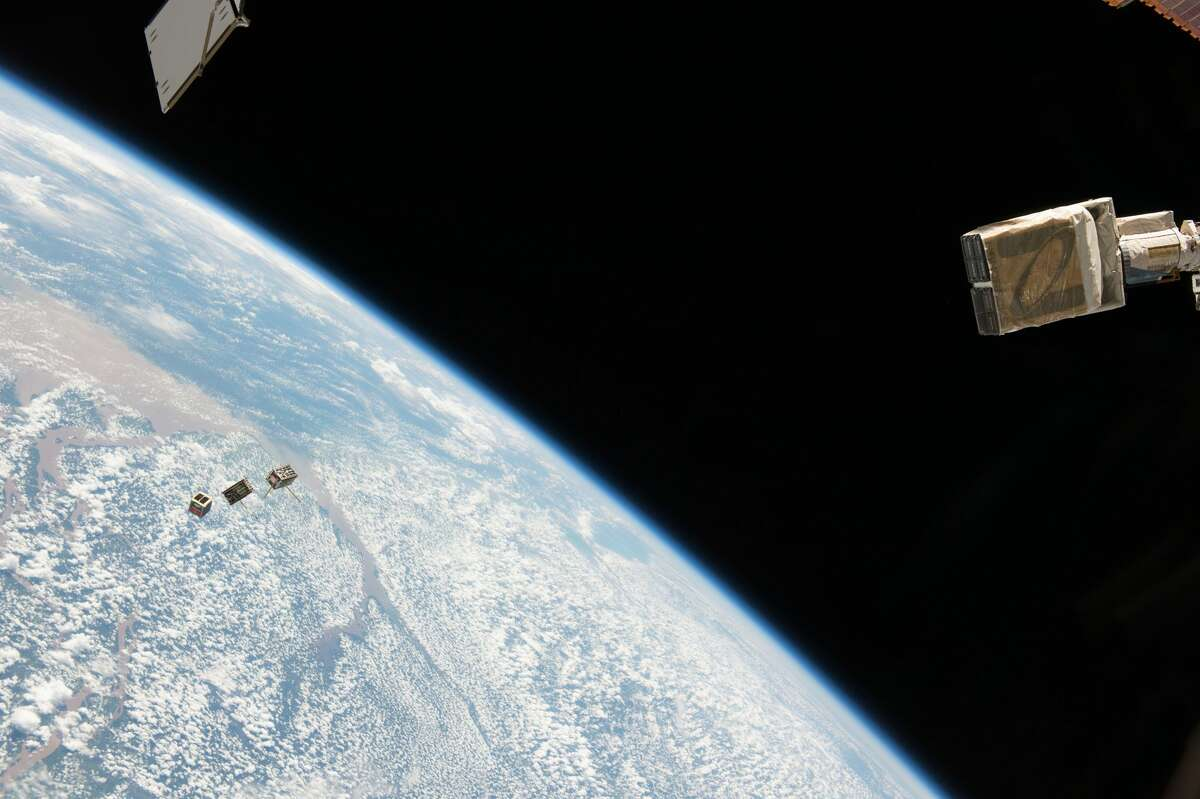 NanoRacks CubeSat Deployer is deploying three CubeSat satellites from the International Space Station.