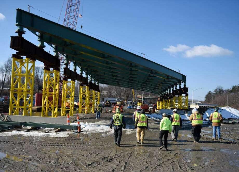 The construction crew works on the new overpass being built spanning I-95's Exit 9 in Stamford, Conn. Photo: / Tyler Sizemore / Hearst Media