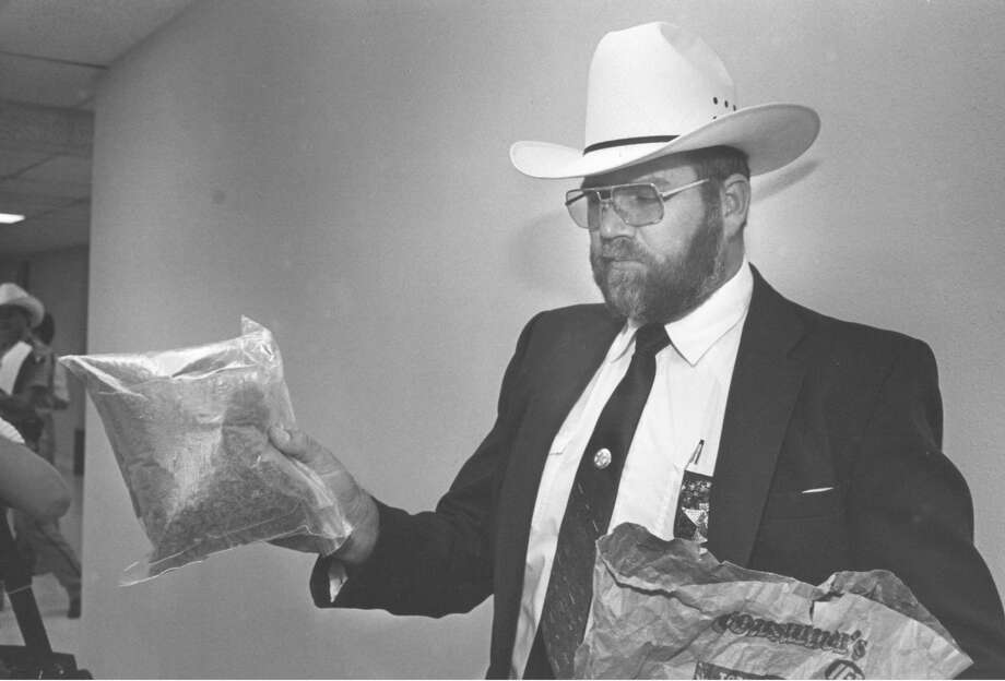 "Midland County Sheriff Gary Painter with ""alleged"" marijuana. Photo: Midland Reporter-Telegram"