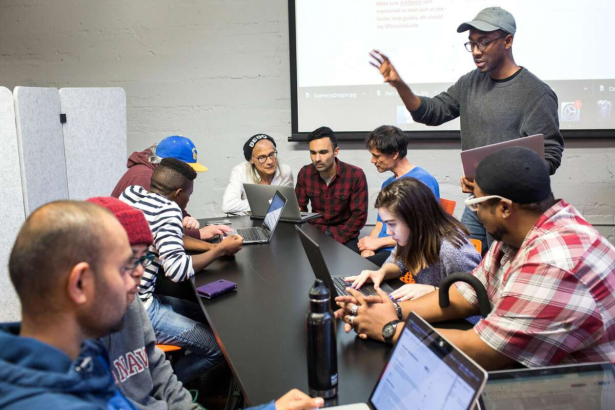Attendees engage with volunteers during Datathon, an event initiated by nonprofit Shelter Tech during which volunteers work alongside homeless and formerly homeless people to verify and expand its database of services available for homeless people. At Intersection for the Arts on Tuesday, May 21, 2019. San Francisco, Calif.