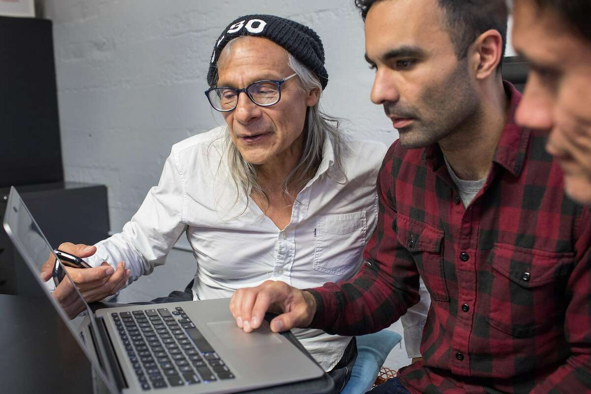 Aaron Mendez, left, Community Representative and homeless for 18 years works with Michael Polce, volunteer, during Datathon, an event initiated by nonprofit Shelter Tech during which volunteers work alongside homeless and formerly homeless people to verify and expand its database of services available for homeless people. At Intersection for the Arts on Tuesday, May 21, 2019. San Francisco, Calif.
