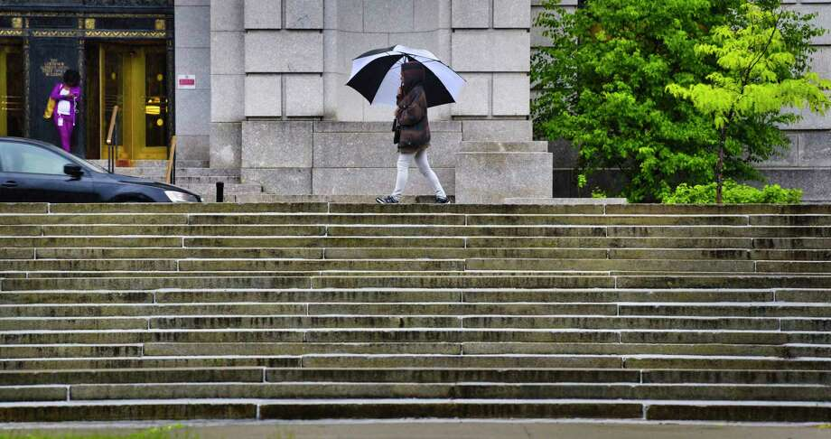 The rain will be back on Tuesday. In this photograph, a woman makes her way in the rain along South Swan Street on Tuesday, May 28, 2019, in Albany, N.Y.  (Paul Buckowski/Times Union) Photo: Paul Buckowski, Albany Times Union / (Paul Buckowski/Times Union)