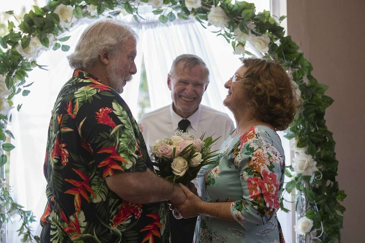 Vickey Gauwitz and Steve Baker are married, their second marriage to each other, by Rev. Don Lang, center, at the Courthouse Wedding Chapel in San Antonio on Friday, May 24, 2019.