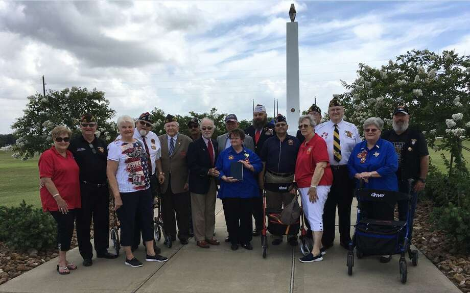 Members of the Rotary Club of Katy and Katy Veterans of Foreign Wars Post 9182 and its Auxiliary were joined by Fort Bend County Precinct 3 Commissioner Andy Meyers andJeff Pantle of JP Southwest Concrete Inc. at a Memorial Day program held May 27 at Freedom Park Memorial Tower. Photo: Karen Zurawski / Karen Zurawski