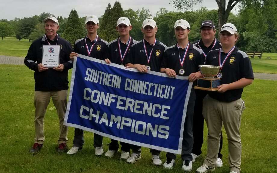 Members of the Hand golf team pose with the championship banner after winning the SCC title on Tuesday. Photo: Joe Morelli / Hearst Connecticut Media