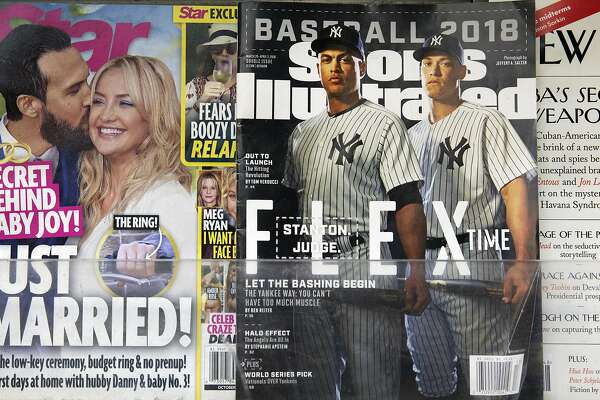 An issue of Sports Illustrated is displayed on a newsstand, Tuesday, May 28, 2019 in New York. Authentic Brands Group, which manages retail names like Juicy Couture and Nautica, is buying the sports magazine for $110 million. (AP Photo/Mark Lennihan)