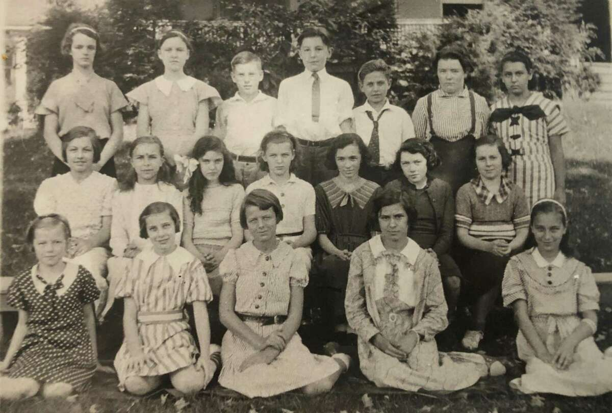 """St. Francis School in New Milford celebrated its first graduating class in 1935. Among the graduates were, from left to right, in front, Geraldine Hulton, Veronica McMahon, Minnie Halpine, Helen Syniec and Lorraine Reynolds; second row, Theresa Raino, Josephine Kozieleic, Beatrice Martin, Phyllis Lawlor, Mary Ward, Shirley Harris and Jeanne Cuddy; and in back, Joan Carson, Mary Dolan, Paul E. Martin, William Moore, Joseph Kracheski, Marjorie Frizzel and Josephine Boucher. If you have a """"Way Back When"""" photo you'd like to share, contact Deborah Rose at drose@newstimes.com or 860-355-7324."""